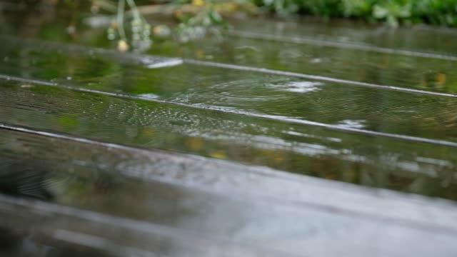 closeup of the planks of a terrace in the rain - terrazza video stock e b–roll
