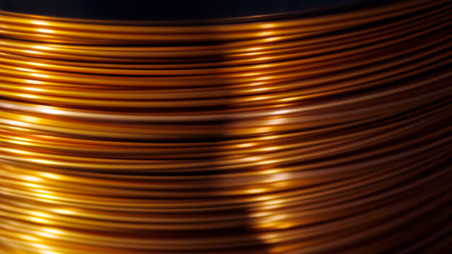 close-up of the rotation of the coil and wrap it copper wire. Manufacture of electric cable. close-up of the rotation of the coil and wrap it copper wire. Manufacture of electric cable copper stock videos & royalty-free footage