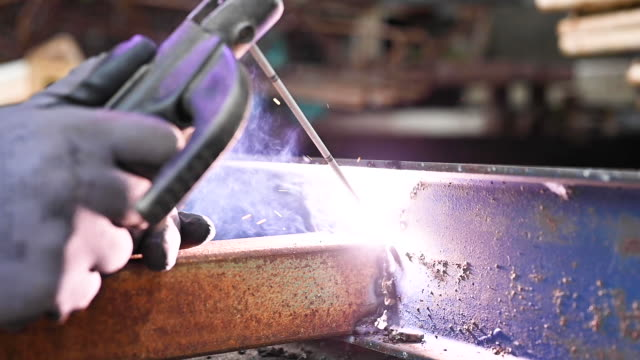 Close-up of the welding process of two metal parts in slow motion.
