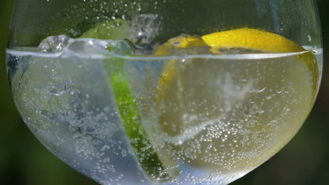 Close-up of tonic water with ice, lemon and lime. Slow motion tonic water stock videos & royalty-free footage