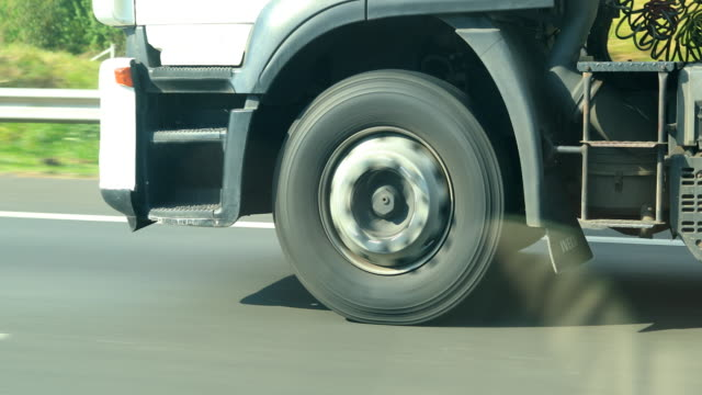 Closeup of truck tires driving on highway road in 4K video