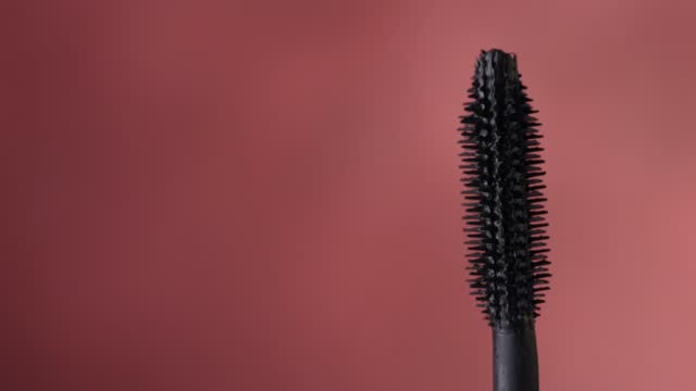 closeup of turning black mascara brush closeup of turning black mascara brush mascara stock videos & royalty-free footage