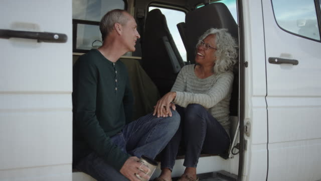 Closeup of Two Adventurous Seniors Chatting in Their Campervan video