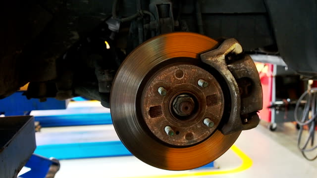 Close-up of unmounted brakes and suspension of a car video