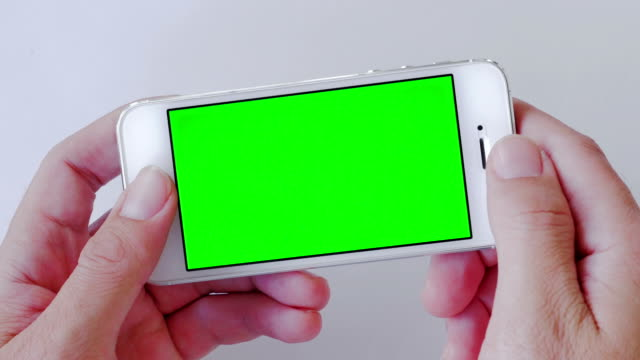 Close-up of Using smart phone,Green screen video