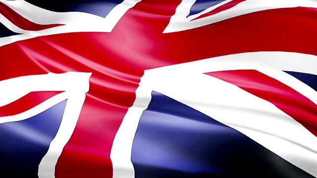 closeup of waving flag of Union Jack, uk england,  united kingdom flag, seamless looping video