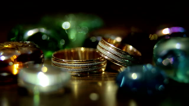 Close-up of wedding rings on a bright background. Close-up of wedding rings on a bright iridescent background. brushed metal stock videos & royalty-free footage