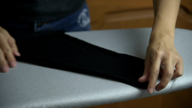 Close-up Of Woman Ironing Clothes With A Steaming Iron video