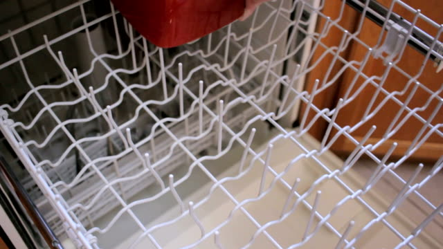 Closeup of Woman Loading a Dishwasher video