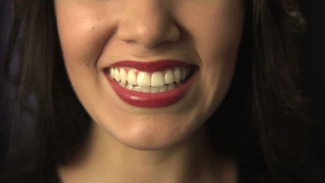 Closeup of woman smiling laughing and blowing kiss video