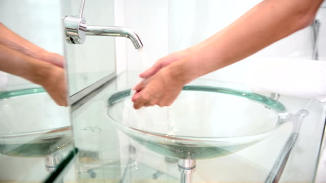 Close-up of woman washing hands video