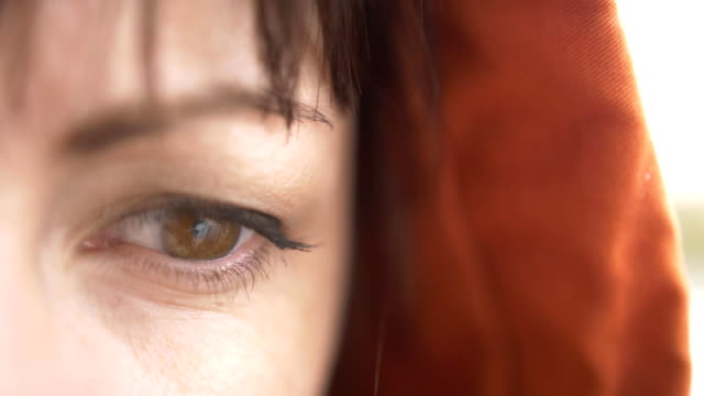 Close-up of woman wearing contact lens, Sad look video