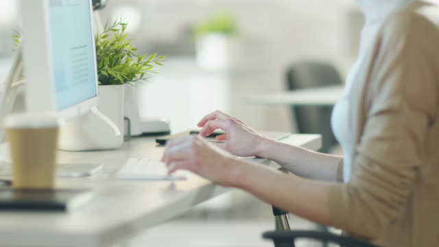 Close-up of Woman's Hands Typing on a Keyboard Using Her personal Computer in Very Lightsome Modern Environment. video
