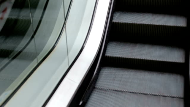 Close-up of working escalator in the shopping center.