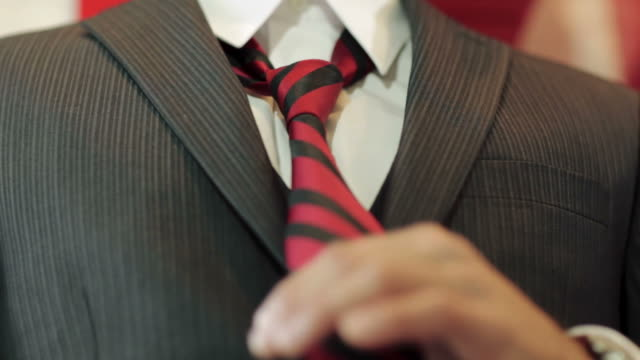 close-up of young man's hands as he fixes his tie - prom fashion stock videos and b-roll footage