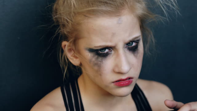 Closeup of young teenage girl dancer crying after loss perfomance sits on floor in dance studio indoors Closeup of young teenage girl dancer crying after loss perfomance sits on floor in dance studio mascara stock videos & royalty-free footage