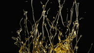 istock Close-up Oil Splashing and Flowing Isolated on Black Background. Slow Motion Shot of Splash Golden Liquid on Dark Backdrop. Flow Drops of Organic Gold Oil. Colorful Concept of Splash Liquid Oil HDR 4k 1293152700