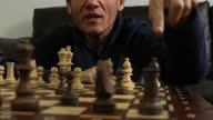 istock Close-up on pensive trans autistic male over a chess board discussing moves 1286214826