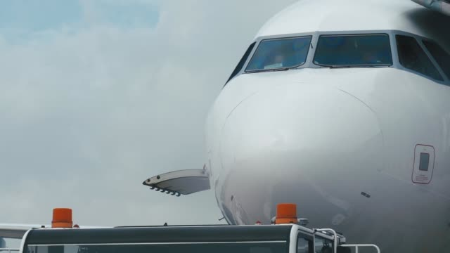 Close-up outside cabin a large white aircraft video