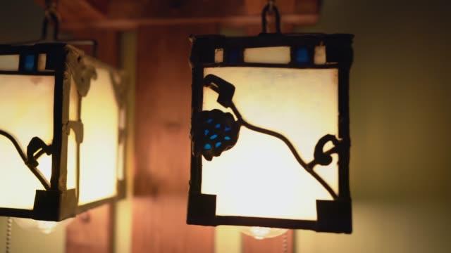 closeup panning craftsman antiques light fixture This closeup panning video shows beautiful craftsman antiques light fixtures. victorian architecture stock videos & royalty-free footage