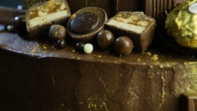 closeup panorama on decoration of chocolate cake - theobroma video stock e b–roll