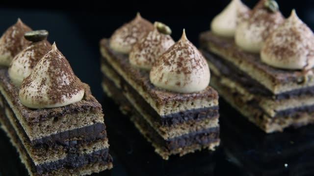 closeup panorama right on opera cake slices - decorazione per dolci video stock e b–roll