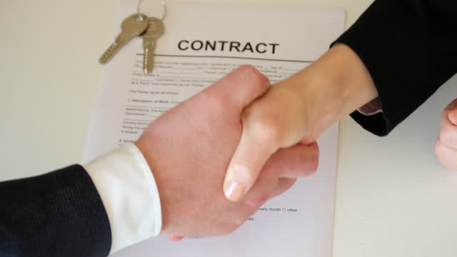 Closeup part of human body a man and a woman shake hands, conclude successful contract agreement. Buy a house. USA, Business, Handshake, Contract, Customer mortgages and loans stock videos & royalty-free footage