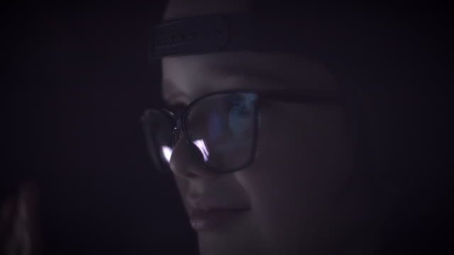 4K Close-up PC Reflection in Glasses of a Child Eyes video