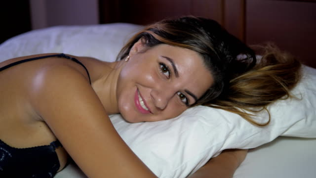 Closeup Portrait In Bed On The Pillow Nice Woman With Big Eyes In MakeUp Smiling video