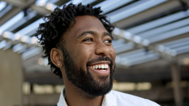 closeup portrait of a young black man - distrarre lo sguardo video stock e b–roll