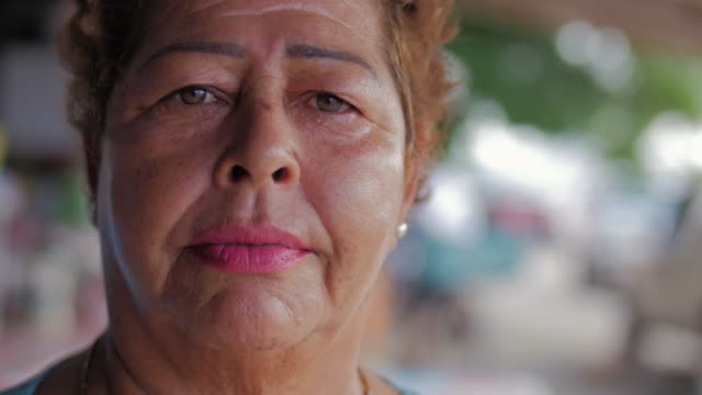 Close-up portrait of an older hispanic woman looking worried in Mexico video