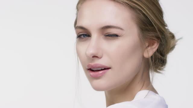Close-up portrait of beautiful winking woman