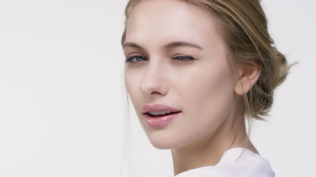 close-up portrait of beautiful winking woman - pelle video stock e b–roll