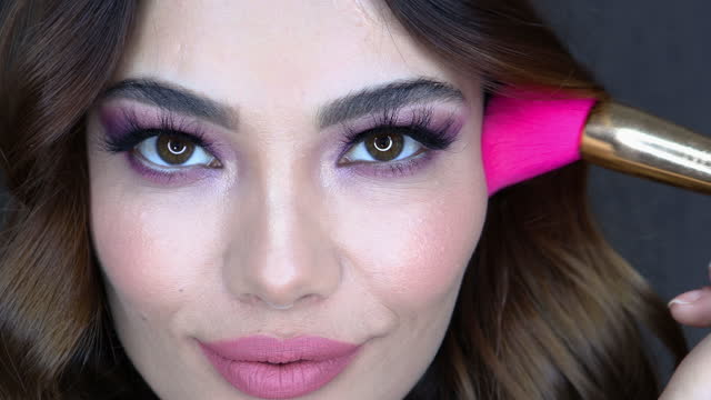 Closeup portrait of beautiful woman with bright make-up and pink lips. Attractive model with a pink lipstick. Closeup portrait of beautiful woman with bright make-up and pink lips. Attractive model with a pink lipstick. mascara stock videos & royalty-free footage