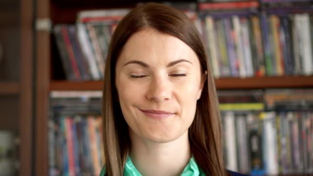 closeup portrait of cheerful joyful content happy young woman sincere powerful emotions on face - podnosić filmów i materiałów b-roll