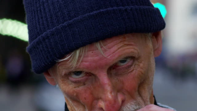 Closeup portrait of homeless man video