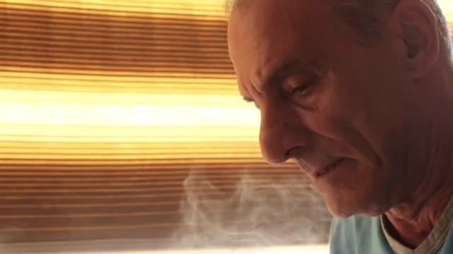 closeup portrait of old man smoking: smoke, cigarette video