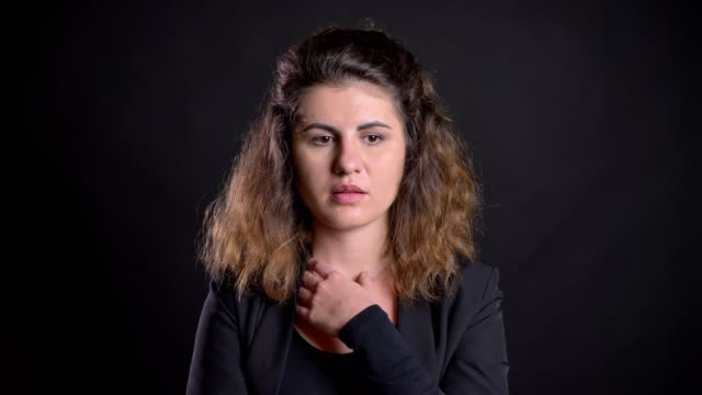 Close-up portrait of overweight caucasian woman perplexedly thinking on black background. Close-up portrait of overweight caucasian woman perplexedly thinking on black background plus size model stock videos & royalty-free footage