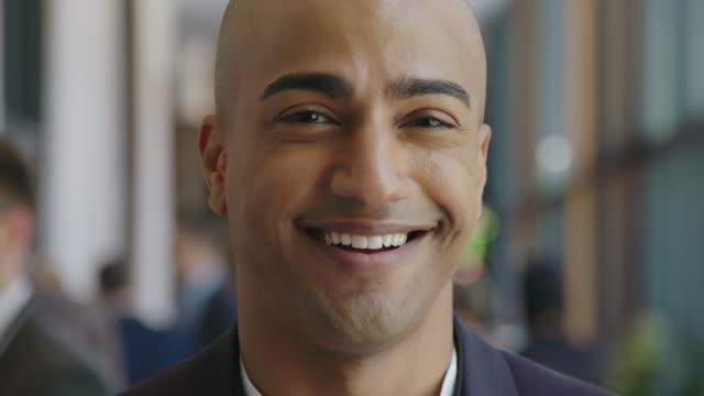 Close-up portrait of smiling bald businessman