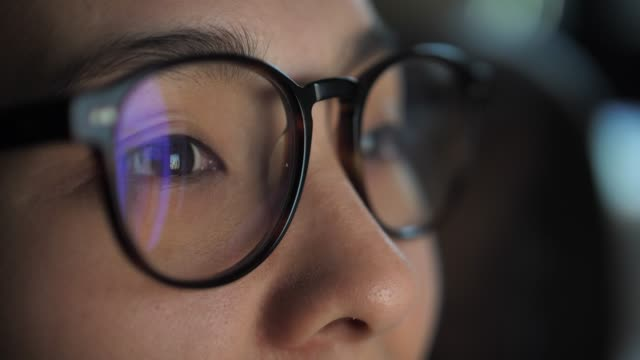 close-up portrait of smiling businesswoman working at modern office and using computer touchscreen, looking at monitor - lente strumento ottico video stock e b–roll