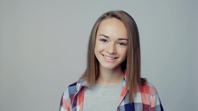 Closeup portrait of teen girl looking at camera smiling video