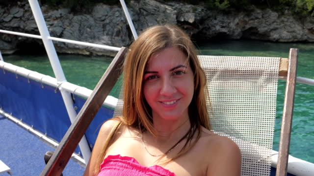 Closeup Portrait Of Woman Smiling While Sitting On A Lounger By The Azure Sea video
