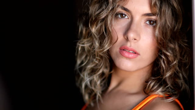 Closeup portrait of young attractive caucasian woman video
