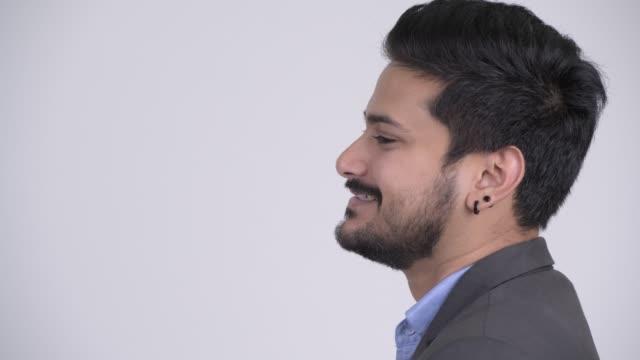 närbild profil bild av glada unga skäggiga indiska affärsman - kostym sida bildbanksvideor och videomaterial från bakom kulisserna