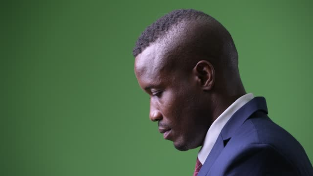 Video Closeup profile view of young African businessman looking up