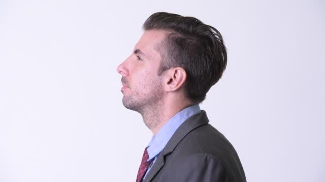 närbild profil syn på unga stilig spansktalande affärsman i kostym - kostym sida bildbanksvideor och videomaterial från bakom kulisserna