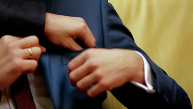 Close-up: Putting Boutonniere Into Pocket video