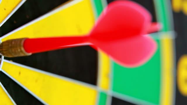 closeup red dart arrow business solutions and success concept.