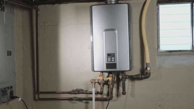 Closeup Reveal Tankless Water Heater From Behind Wall