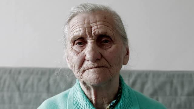 Close-up sad old woman portrait . video